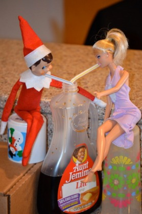 elf on a shelf drinking syrup